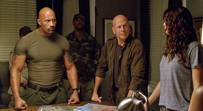 Dwayne Johnson with Bruce Willis and Adrianne Palicki in G.I. Joe: Retaliation (2013). Dwayne's height is 6'10''.